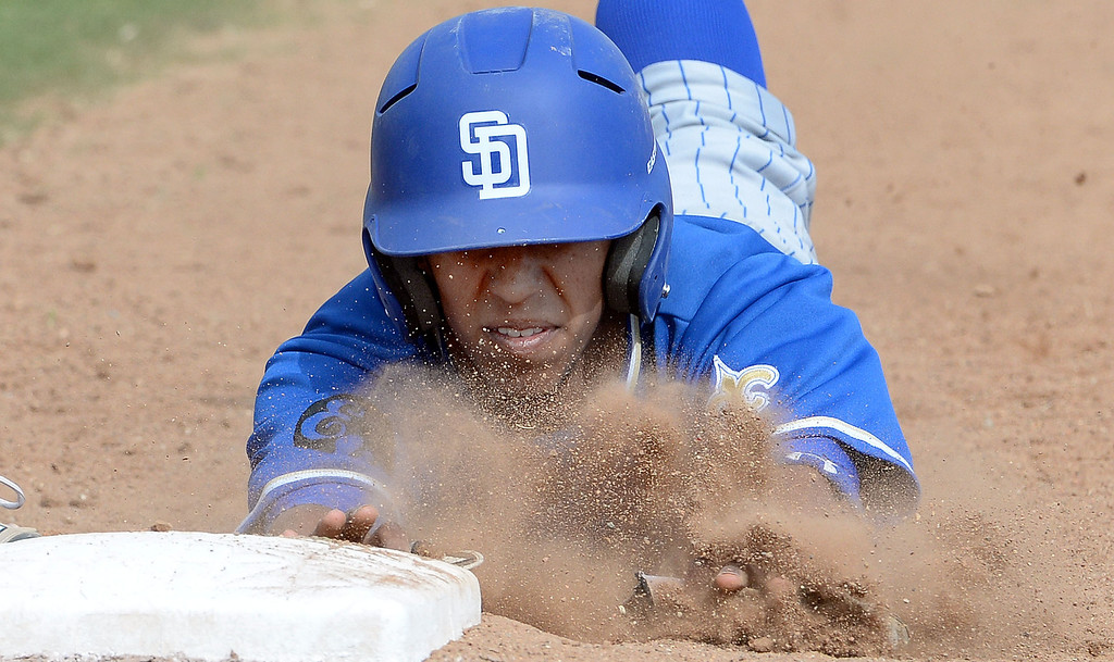 Description of . San Dimas' Josh Corona dives back to first base ahead of the tag in the third inning of a prep baseball game against San Dimas at Northview High School in Covina, Calif., on Wednesday, March 26, 2014. San Dimas won 2-0.