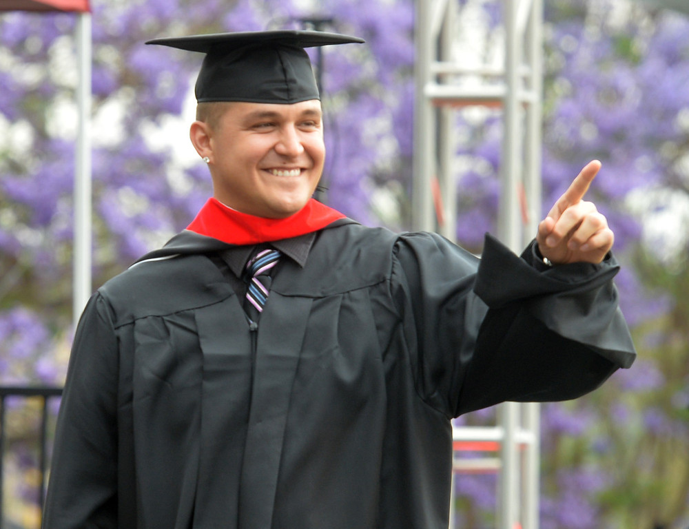 Description of . David Hefner point to family during the Commencement Ceremony at Biola University in La Mirada on Friday May 23, 2014. Kay Warren, International speaker and author, gives the commencement address. (Photo by Keith Durflinger/Whittier Daily News)