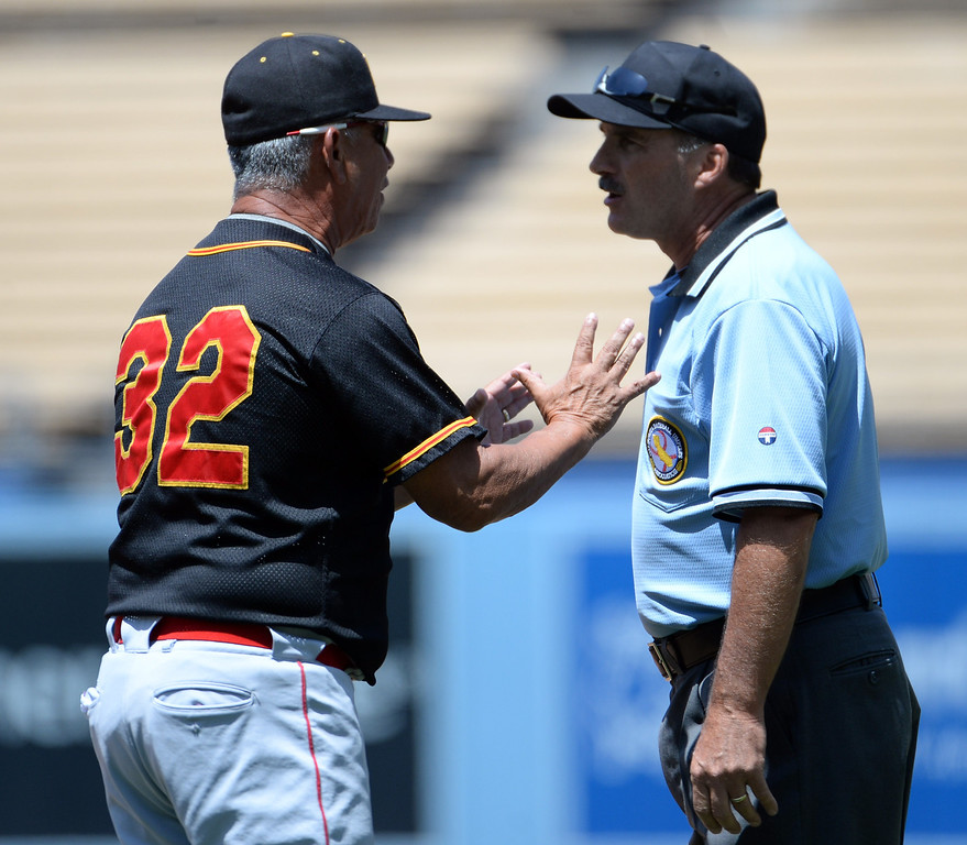 Description of . Palm Desert head coach Darol Salazar argues over a safe call at first base in the second inning of the CIF-SS Division 3 baseball championship against Bishop Amat at Dodger Stadium in Los Angeles on Friday, June 6, 2014. Bishop Amat won 4-3.   (Keith Birmingham/Pasadena Star-News)