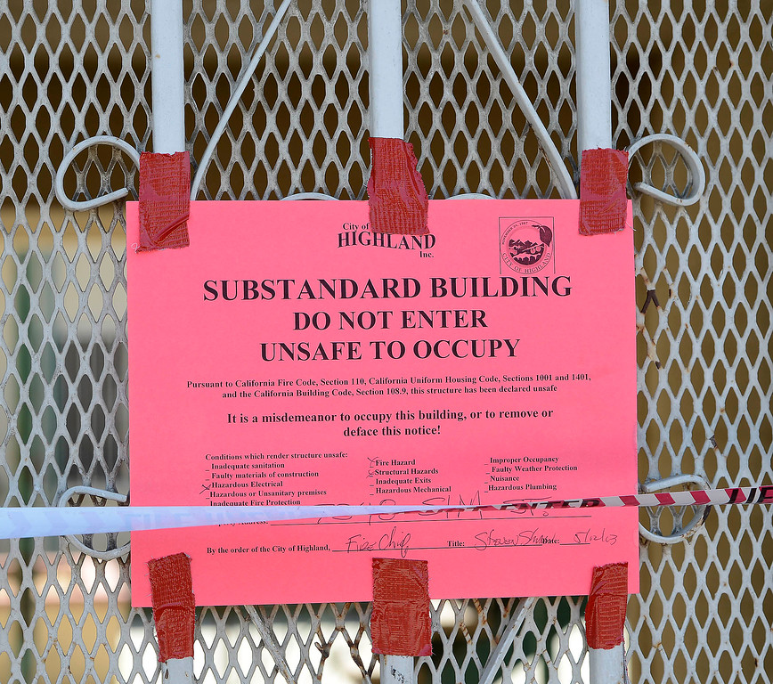 Description of . The City of Highland has posted a notice on this burned out apartment along the 7200 block of Elm Street May 13, 2013. The notice reads:  Substandard Building. Do Not Enter. Unsafe To Occupy.   The  GABRIEL LUIS ACOSTA/STAFF PHOTOGRAPHER.
