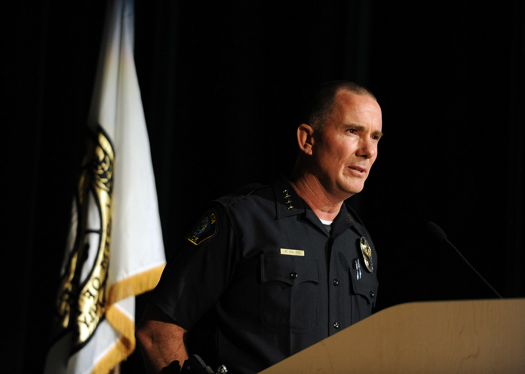Description of . Murrieta Police Chief Sean Haddon speaks during a town hall meeting on Wednesday, July 2, 2014 at Murrieta Mesa High School in Murrieta, Ca. The meeting is being held in response to immigrants who were being processed through a Texas Border Patrol Station and delivered to the Murrieta Border Patrol Station on Tuesday, which created protests from both sides of the immigration issue. (Micah Escamilla/The Sun)