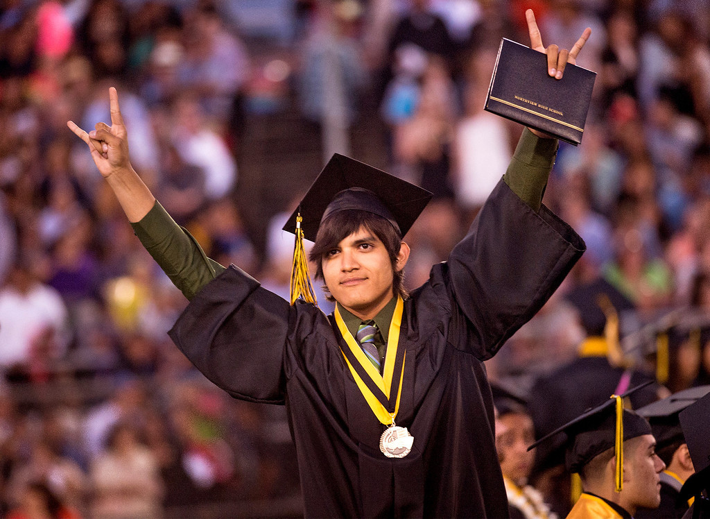 Description of . Michael Lopez jubilates during the Northview High commencement ceremony at Covina District Field June 11, 2014.   (Staff photo by Leo Jarzomb/San Gabriel Valley Tribune)