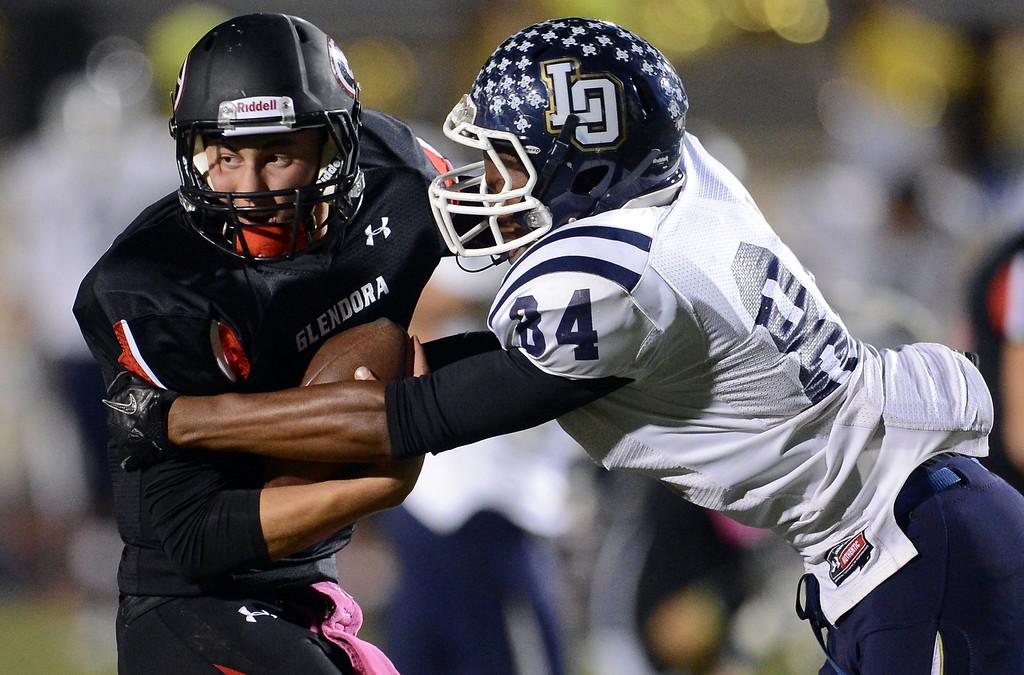 Description of . Los Osos' Michael West (84) sacks Glendora quarterback Matt Fink (12) in the first half of a prep football game at Citrus College in Glendora, Calif., on Thursday, Oct. 31, 2013.    (Keith Birmingham Pasadena Star-News)