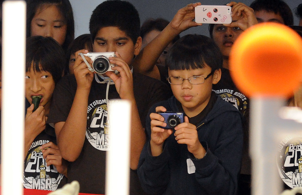 Description of . Students photograph the competition during the Botball Regional Tournament, part of standards-based educational robotics program. Part of a national program to encourage kids to study math, science. Kids from schools in LA County will compete to see who built best robot at the Shrine Expo Hall on Saturday, March 4, 2013 in Los Angeles.    (Keith Birmingham Pasadena Star-News)