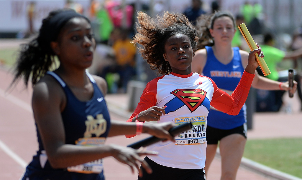 Description of . Serra competes in the 4x100 meter relay Invitational during the Mt. SAC Relays in Hilmer Lodge Stadium on the campus of Mt. San Antonio College in Walnut, Calif., on Saturday, April 19, 2014. 