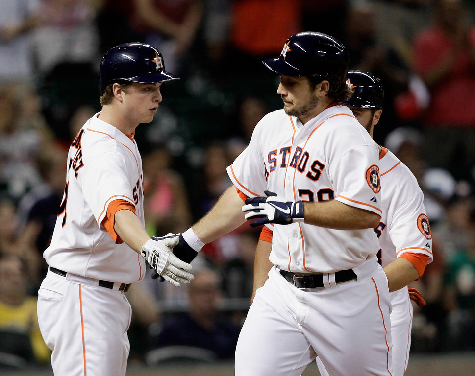 Description of . HOUSTON, TX - SEPTEMBER 14:  Brett Wallace #29 of the Houston Astros is congratulated by Matt Dominguez #30 of the Houston Astros after hitting a home run in the fourth inning against the Los Angeles Angels of Anaheim at Minute Maid Park on September 14, 2013 in Houston, Texas.  (Photo by Bob Levey/Getty Images)