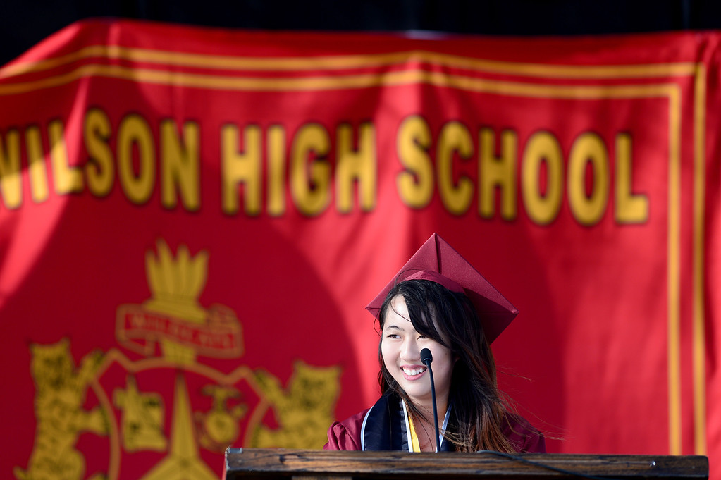 Description of . Fiona Xin gives the salutatorian address during Wilson High School's forty-seventh commencement ceremony Tuesday evening, May 20, 2014 at the Hacienda Heights school. (Photo by Sarah Reingewirtz/Pasadena Star-News)