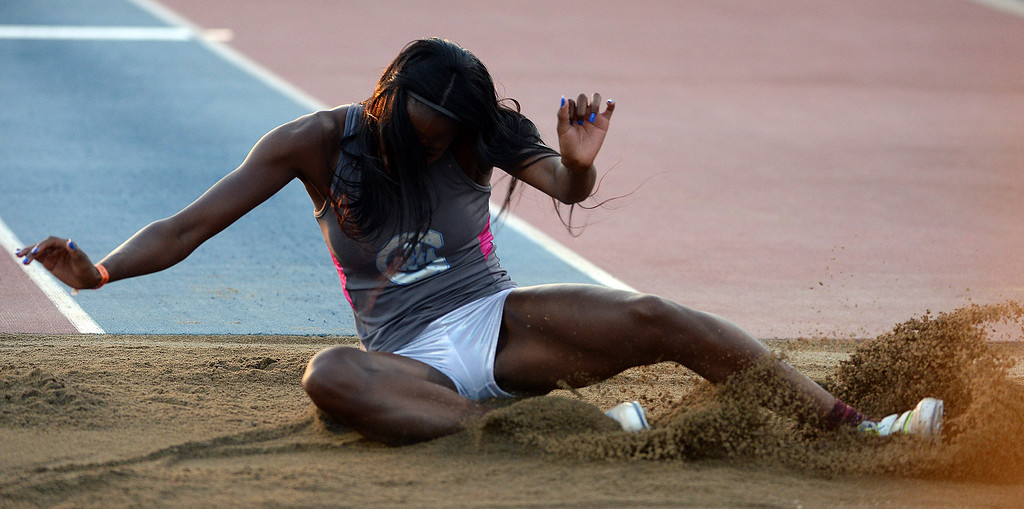 Description of . Carson's Ashley Anderson competes in the triple jump during the CIF California State Track & Field Championships at Veteran's Memorial Stadium on the campus of Buchanan High School in Clovis, Calif., on Saturday, June 7, 2014. 