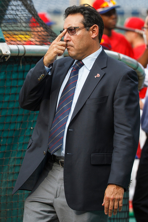 Description of . Philadelphia Phillies' Ruben Amaro Jr. looks on while the team warms before a baseball game against the Los Angeles Dodgers, Friday, Aug. 16, 2013, in Philadelphia. (AP Photos/Christopher Szagola)