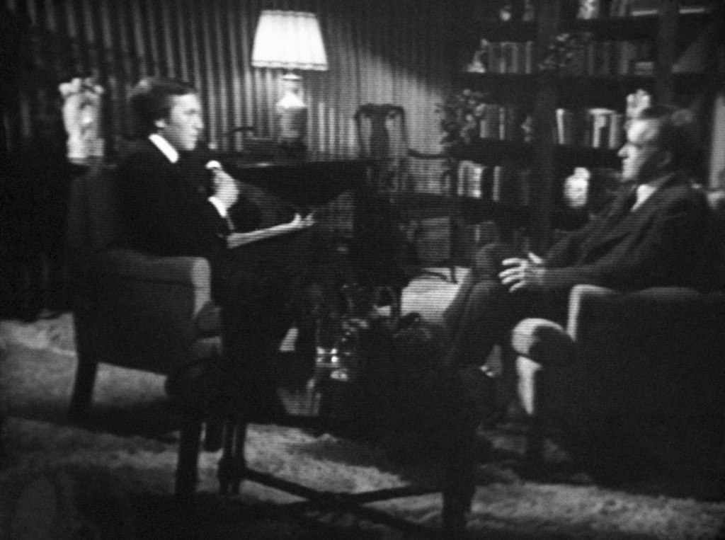 Description of . Former President Richard M. Nixon, right, answers questions of David Frost, left, during paid-for interview that was telecast, Wednesday, May 4, 1977. Interview took place at an unidentified home in South Laguna, Calif. Photo from WNEW - TV monitor. The telecast came 1,000 days after Nixon resigned in disgrace over the Watergate Scandal. (AP Photo/WNEW TV/Ray Stubblebine)