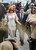 Actress Lindsay Lohan is showered with gold glitter, left, as she walks with her attorney Mark Heller, to attend a trial Monday, March 18, 2013, at  Los Angeles Superior court. Lohan is charged with three misdemeanor counts stemming from a crash on Pacific Coast Highway. She is charged with willfully resisting, obstructing or delaying an officer, providing false information to an officer and reckless driving. She is also accused of violating her probation in a misdemeanor jewelry theft case. (AP Photo/Damian Dovarganes)