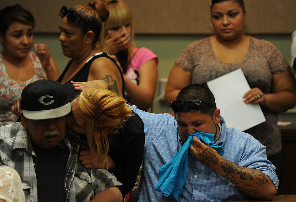 Description of . Family members comfort each other during a press conference at the San Bernardino County Sheriff's Head quarters Thursday August 22, 2013 in San Bernardino. Daniel Olivera 26, of Hesperia was shot and killed at the AM/PM Arco convenience store on August 11, 2013 in Victorville.LaFonzo Carter/Staff Photographe