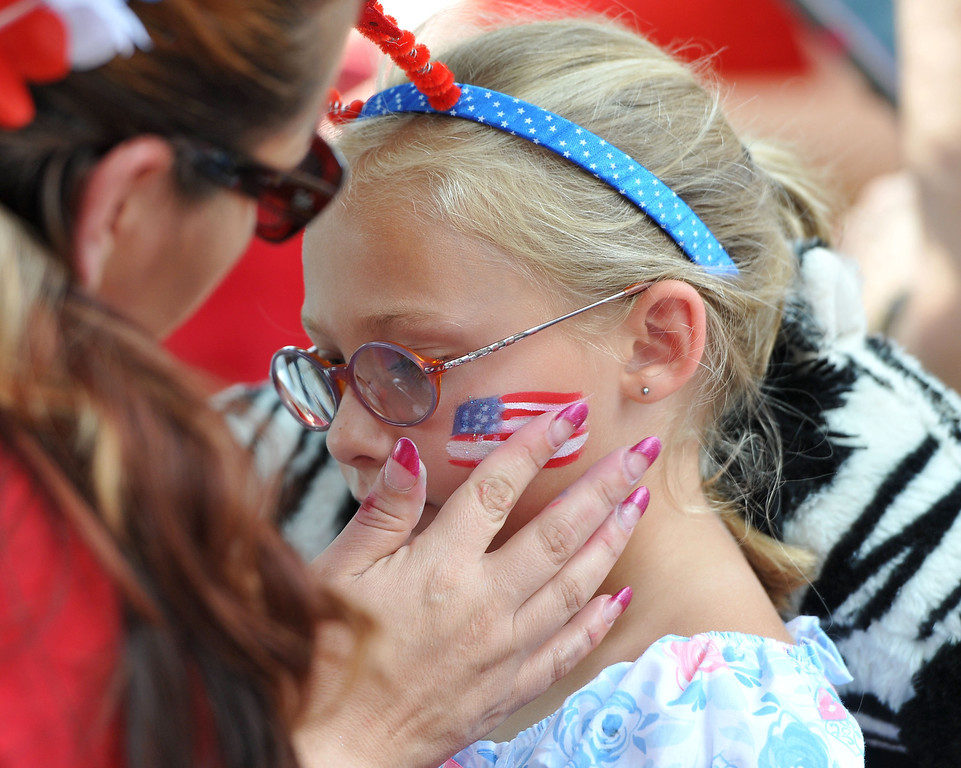 Description of . (John Valenzuela/Staff Photographer) Mia Altenbach, 6, of Redlands has an American flag painted on her cheek during the Redlands Fourth of July Picnic at Sylvan Park in Redlands July 4, 2013.