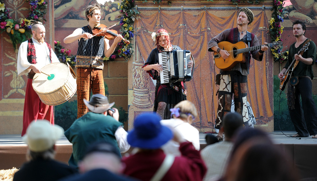 Description of . Musicians perform during Opening day of the Renaissance Pleasure Faire as many dress in period clothing at Santa Fe Dam Recreation Area in Irwindale, Calif., on Saturday, April 5, 2014. 