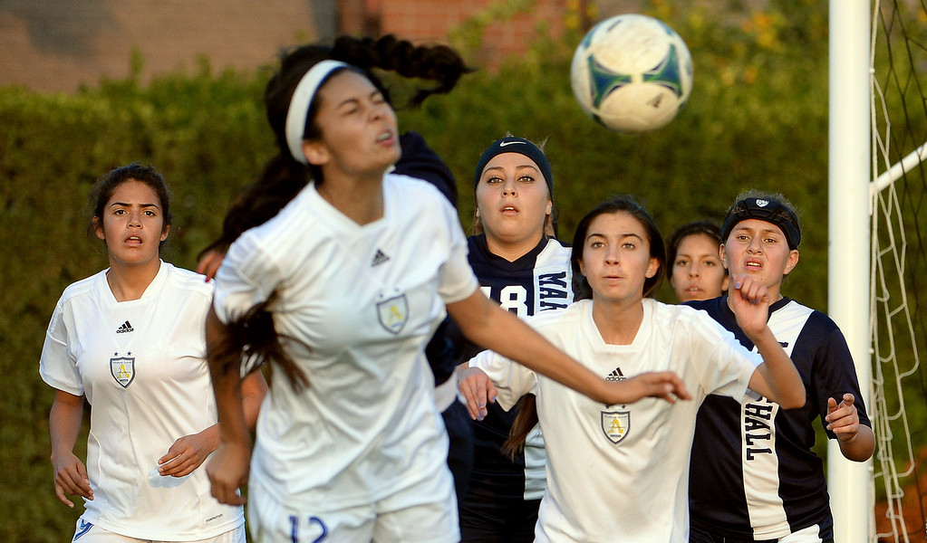 Description of . Bishop Amat's Jamie Peters (12) with the header as teammates look on against Marshall in the first half of a prep soccer match at Bishop Amat High School in La Puente, Calif., on Thursday, Jan. 9, 2014.Amat won 3-0. (Keith Birmingham Pasadena Star-News)