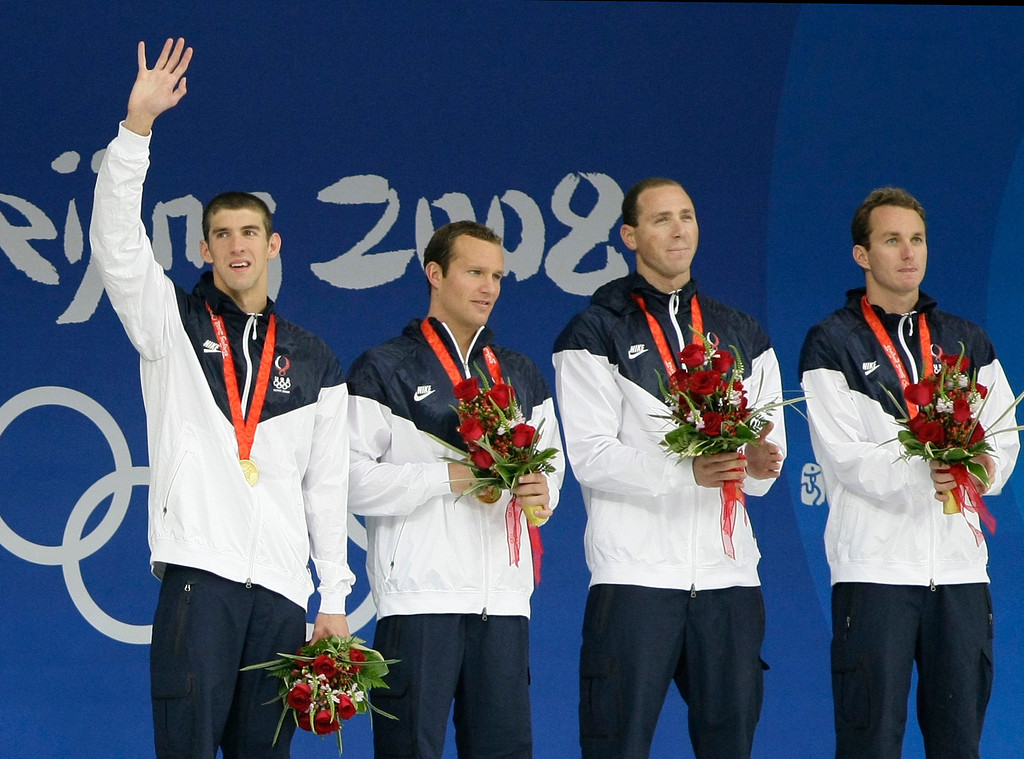 Description of . From right: Aaron Peirsol, Jason Lezak, Brendan Hansen and Michael Phelps of the United States during the medal ceremony for men\'s  4x100-meter medley relay final during the swimming competitions in the National Aquatics Center at the Beijing 2008 Olympics in Beijing, Sunday, Aug. 17, 2008. (AP Photo/Itsuo Inouye)