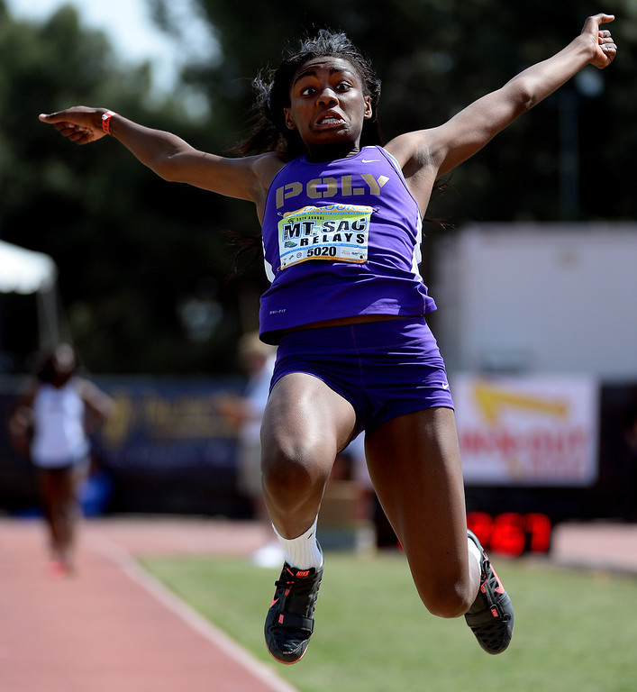 Description of . Long Beach Poly's Zhane Smith competes in the long jump Invitational during the Mt. SAC Relays in Hilmer Lodge Stadium on the campus of Mt. San Antonio College in Walnut, Calif., on Saturday, April 19, 2014. 