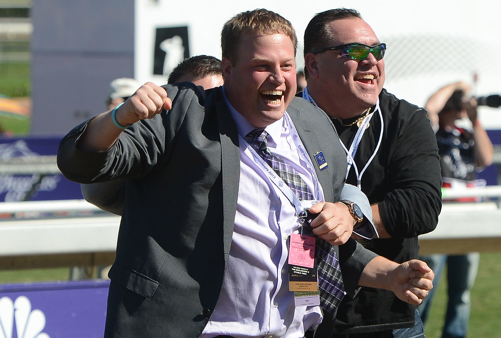 Description of . Owners react in the winning circle after the fourth race during the Breeders' Cup at Santa Anita Park in Arcadia, Calif., on Saturday, Nov. 2, 2013. Jockey Javier Castellano atop