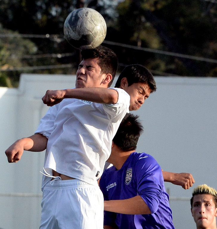 Description of . Monrovia's Brian Nava, left, with the header against Diamond Bar during a second round soccer match at Monrovia High School in Monrovia, Calif., on Tuesday, Feb.25, 2014. Diamond Bar won 3-2 on penalty kicks.