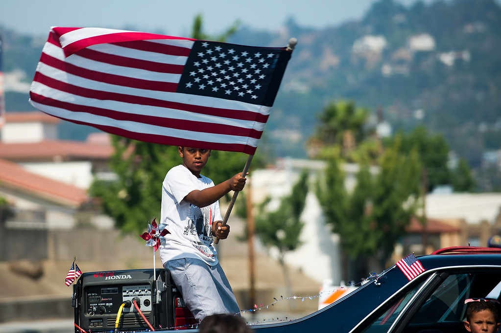 Description of . I Love America parade rolls down Stimson Avenue in Hacienda Heights on Thursday, July 4, 2013. (SGVN/Staff photo by Watchara Phomicinda)