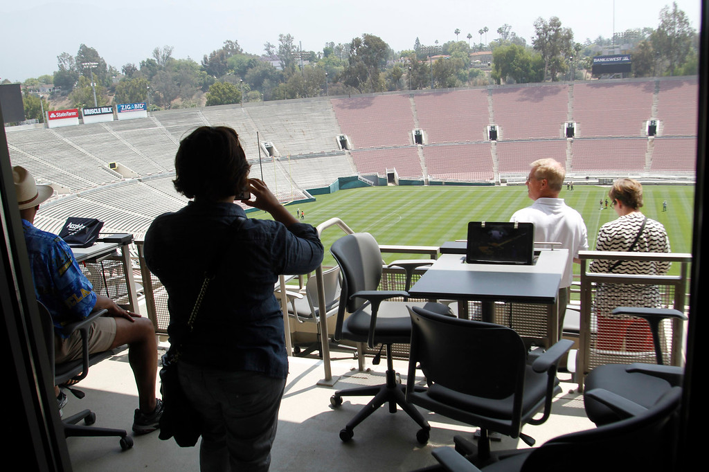 Description of . Guests in the Loge area during a tour of the newly renovated Pavilion at the Rose Bowl in Pasadena, Saturday, June 8, 2013. The new $84 million Pavilion completed this spring after more then two years of construction, contains premium seating section, press box, sound system and stadium security operations. (Correspondent Photo by James Carbone/SXCITY)