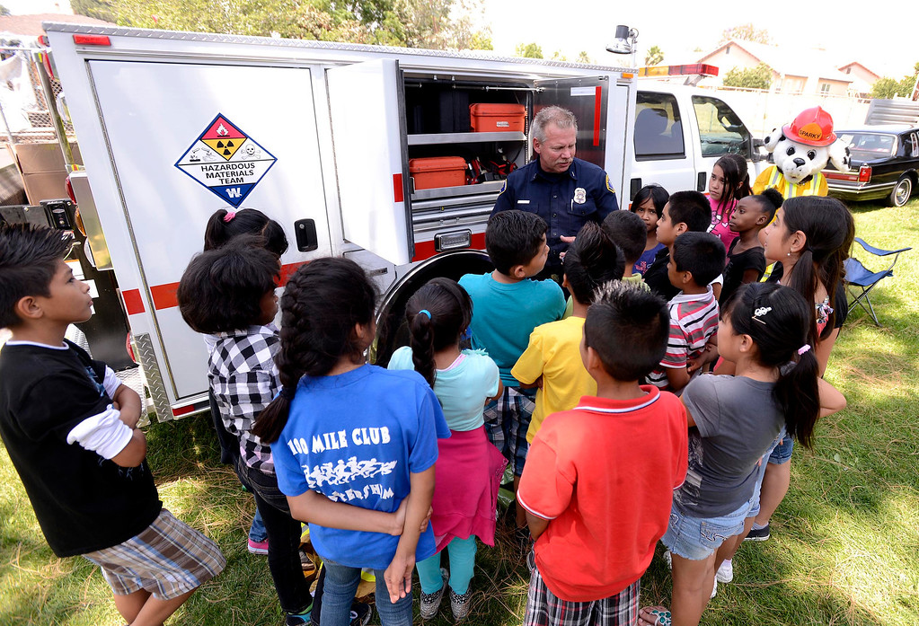 Description of . Brian Otter of San Bernardino County Fire/ Hazardous Material speaks to students about his career during the final day of the 19th Annual Career Awareness Week at Lankershim Elementary School in Highland June 6, 2013.  GABRIEL LUIS ACOSTA/STAFF PHOTOGRAPHER.