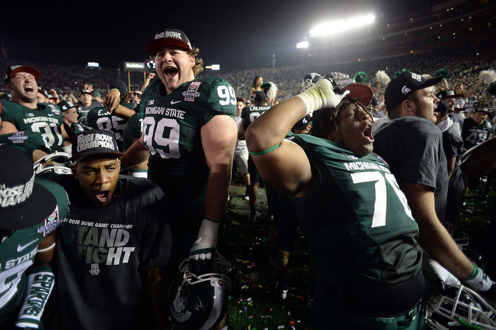 Description of . Michigan State players celebrate during the 100th Rose Bowl game in Pasadena Wednesday, January 1, 2014. Michigan State defeated Stanford 24-20. (Photo by Hans Gutknecht/Los Angeles Daily News)
