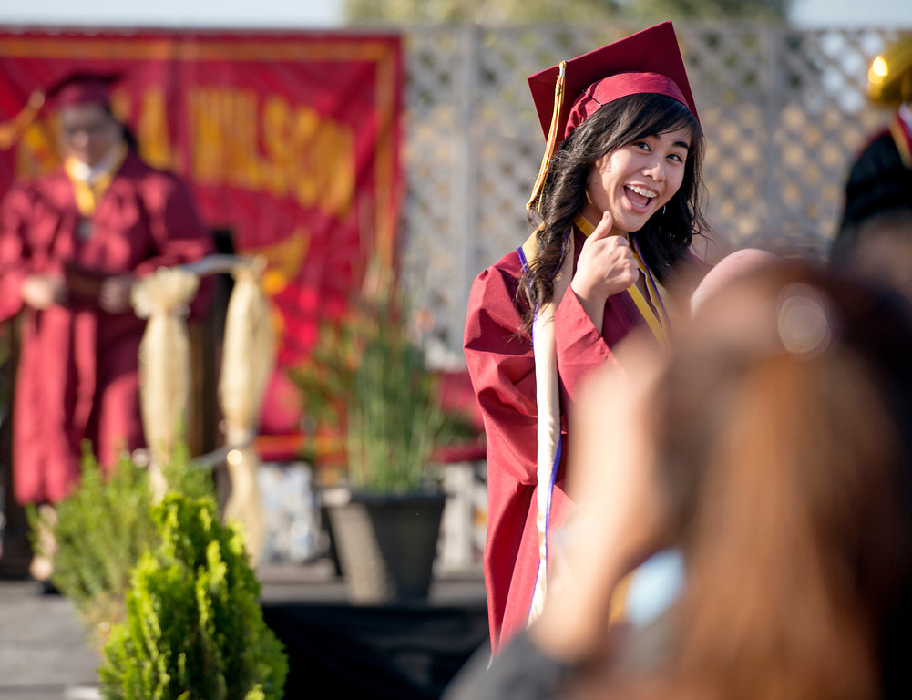 Description of . Wilson High graduates receive diplomas during the 46th annual commencement exercises at the Hacienda Heights campus May 20, 2013.    (SGV Tribune staff photo by Leo Jarzomb)