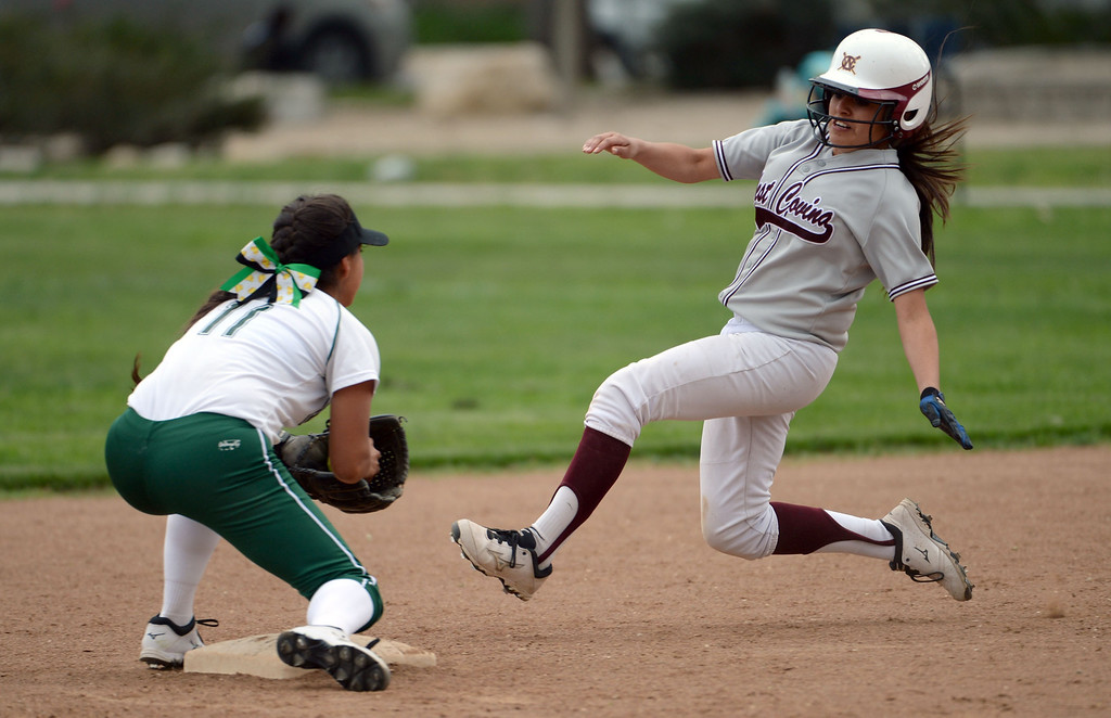 Description of . Bonita shortstop Vienna Benavides (11) tags out West Covina's Miranda Gil on a attempted steal of second base in the fourth inning of a prep softball game at Los Flores Park in La Verne, Calif., on Thursday, March 27, 2014. Bonita won 6-3. (Keith Birmingham Pasadena Star-News)