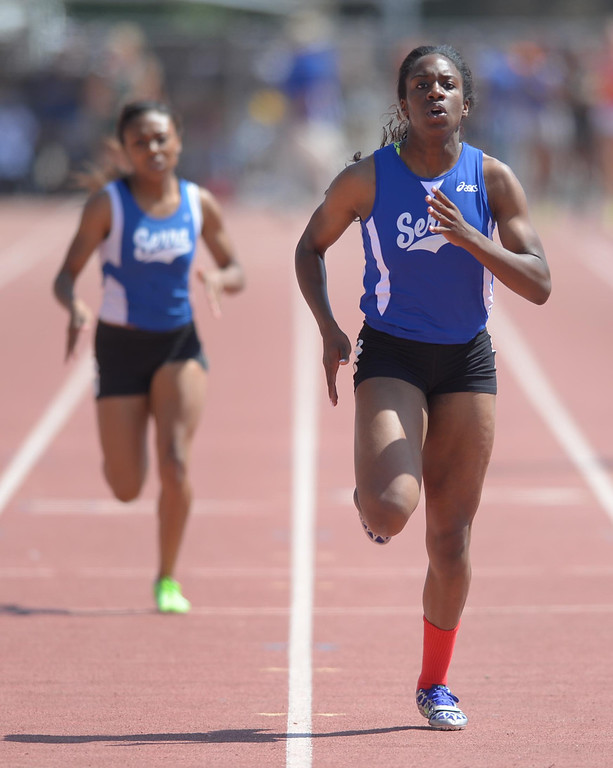 Description of . Serra's Chimere Ezumah wins the 400 meter Division 4 race of the CIF Southern Section Track and Field Championships Saturday at Mt. SAC. Her teammate Gertrude Martin took second. 20130518 Photo by Steve McCrank / Staff Photographer