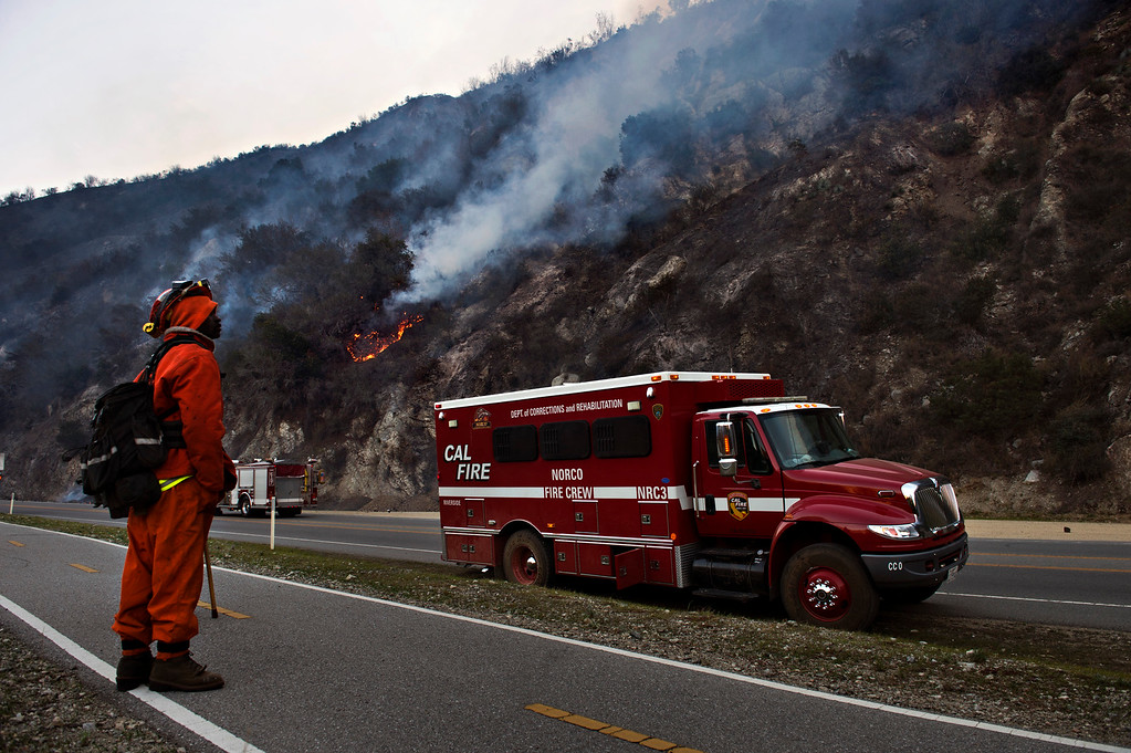 Description of . Fire crews keep a watch on hotspots along Highway 39 near the Mountain Cove community as the Colby Fire burns in Azusa on Friday morning, Jan. 17, 2014. (Photo by Watchara Phomicinda/ San Gabriel Valley Tribune)