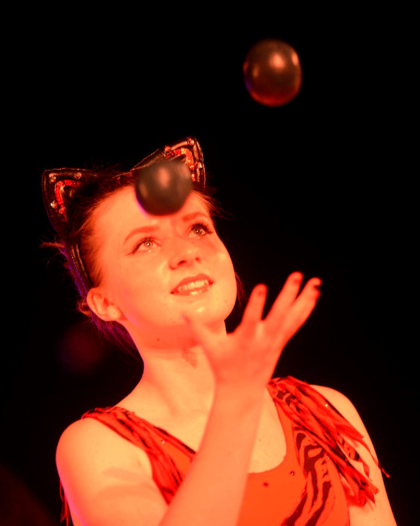 Description of . Aurora McNay juggles during the Great Y Circus in Redlands May 3, 2013.  GABRIEL LUIS ACOSTA/STAFF PHOTOGRAPHER.