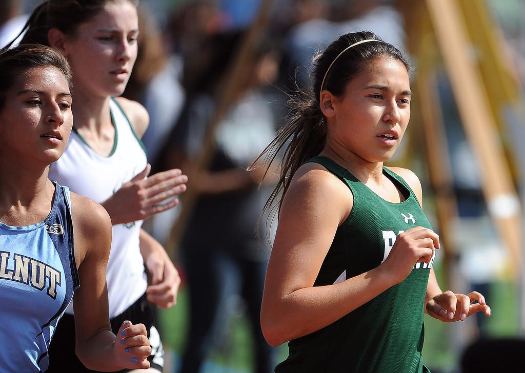 Description of . Bonita's Kailyn Scott, right, along with Walnut's Jessica Gallardo in the 1600 meter race during the Hacienda League track finals in Walnut, Calif., on Thursday, May 8, 2014.  (Keith Birmingham Pasadena Star-News)