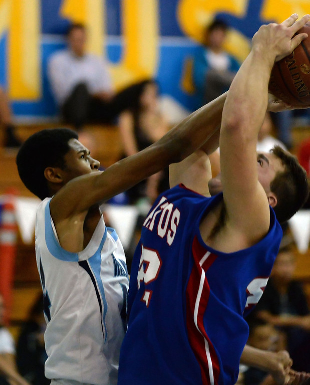 Description of . Walnut's Richard Rycraw (C) (44) blocks the shot of Los Altos' David Tolmachoff (42) in the first half of a prep basketball game at Walnut High School in Walnut, Calif., on Wednesday, Jan. 22, 2014. (Keith Birmingham Pasadena Star-News)