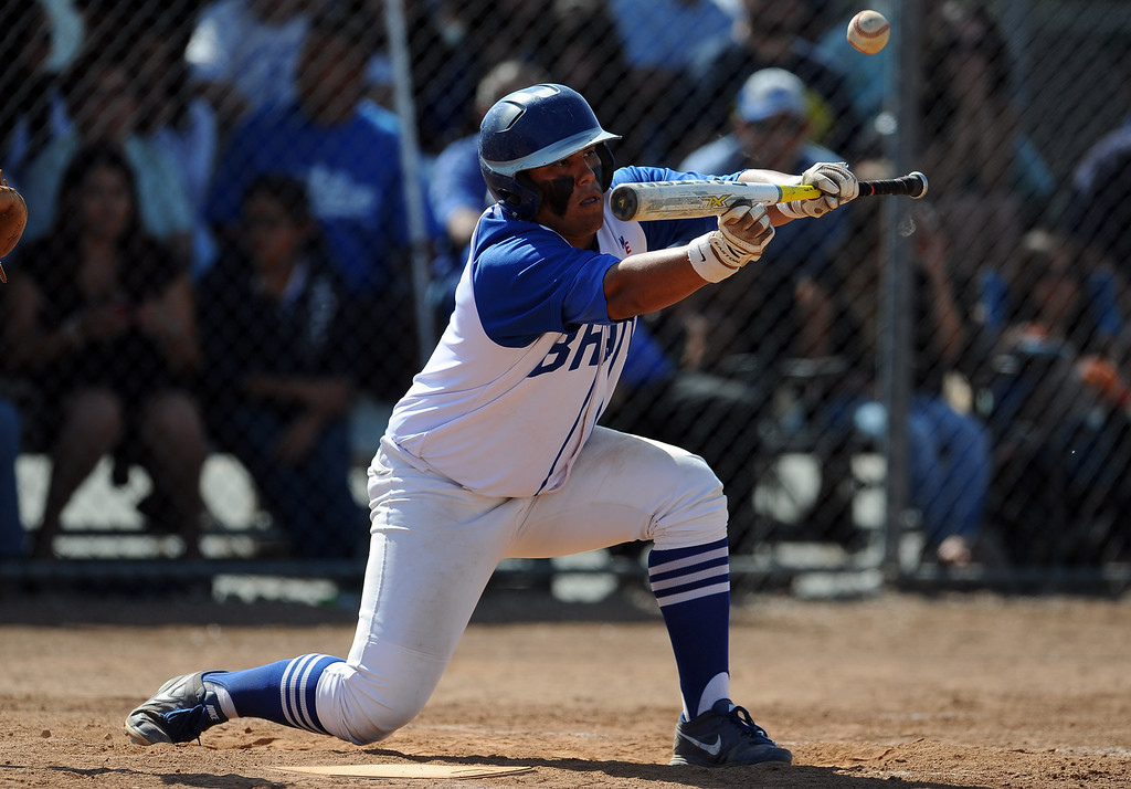 Description of . Baldwin Park's Dominic Hilo bunt single in the fourth inning of a CIF-SS semifinal prep playoff baseball game against El Rancho at Baldwin Park High School on Tuesday, May 28, 2013 in Baldwin Park, Calif.  El Rancho won 5-4.  (Keith Birmingham/Pasadena Star-News)