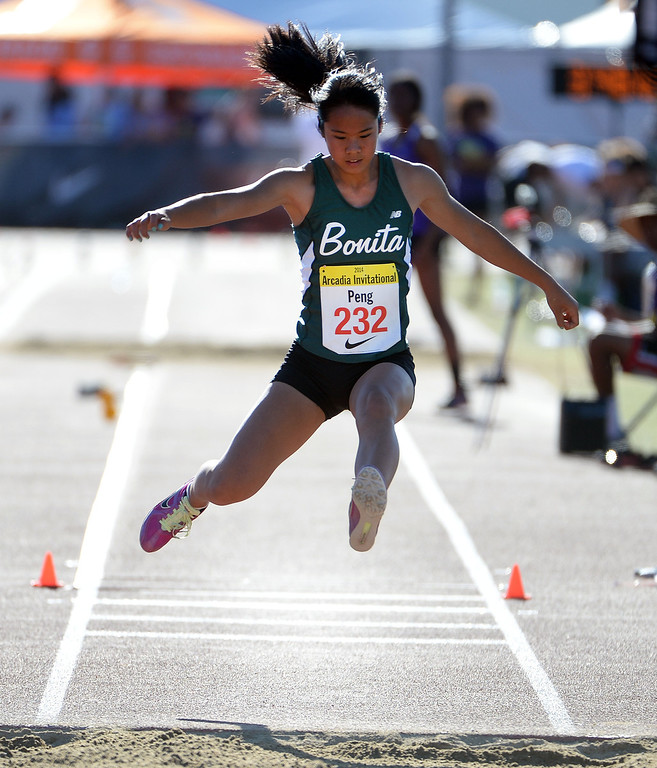 Description of . Bonita's Cassidy Peng in the triple jump during the Arcadia Invitational track and field meet at Arcadia High School in Arcadia, Calif., on Friday, April 11, 2014.  (Keith Birmingham Pasadena Star-News)