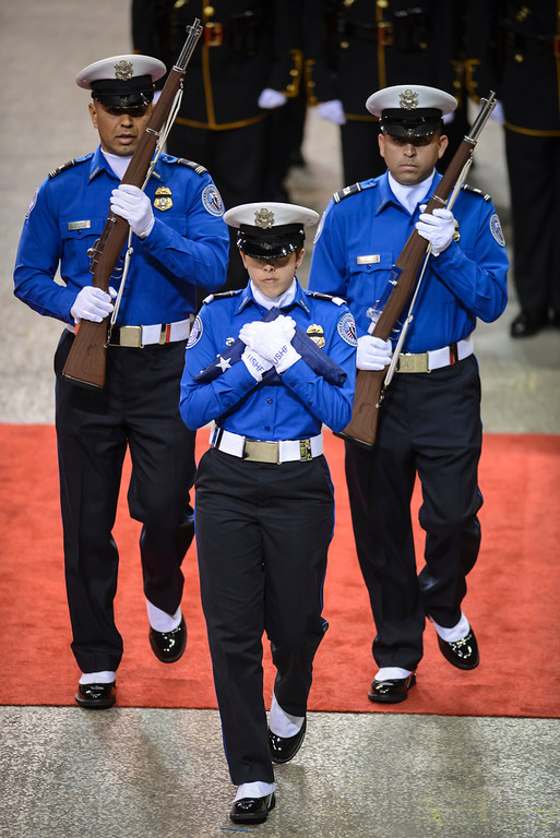 Description of . The flag for slain TSA officer Gerardo Hernandez is carried by TSA officers at the memorial at the Los Angeles Sports Arena Tuesday, November 12, 2013.  A public memorial was held for Officer Hernandez who was killed at LAX when a gunman entered terminal 3 and opened fire with a semi-automatic rifle, Grigsby was wounded in the attack.  ( Photo by David Crane/Los Angeles Daily News )