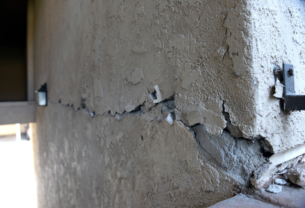 Description of . Cracks are visible at an apartment building on the 2700-block of Associated Road in Fullerton that displaced residents after the 5.1 earthquake centered in La Habra on Saturday March 29, 2014. (Staff Photo by Keith Durflinger/Whittier Daily News)