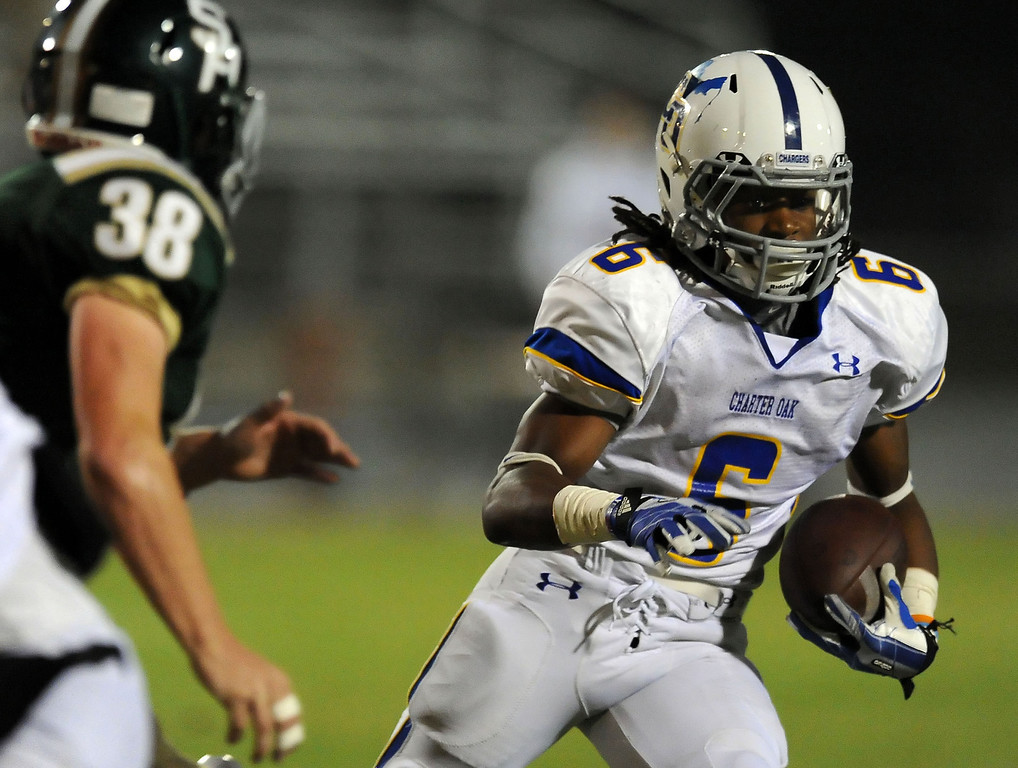 Description of . Charter Oak's Zion Echols (6) runs past South Hills' Mason Behr (38) for a first down in the first half of a prep football game at Covina DIstrict Field in Covina, Calif., on Thursday, Oct. 24, 2013. 
