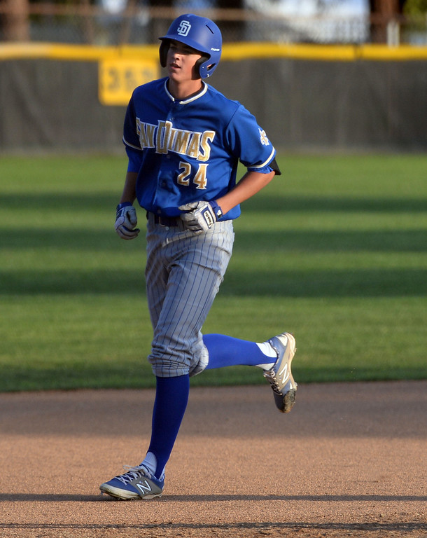 Description of . San Dimas' Peter Lambert (C) rounds third base after hitting a two run home run in the first inning of a prep baseball game against Bonita at Bonita High School in La Verne, Calif., on Wednesday, March 19, 2014.  (Keith Birmingham Pasadena Star-News)