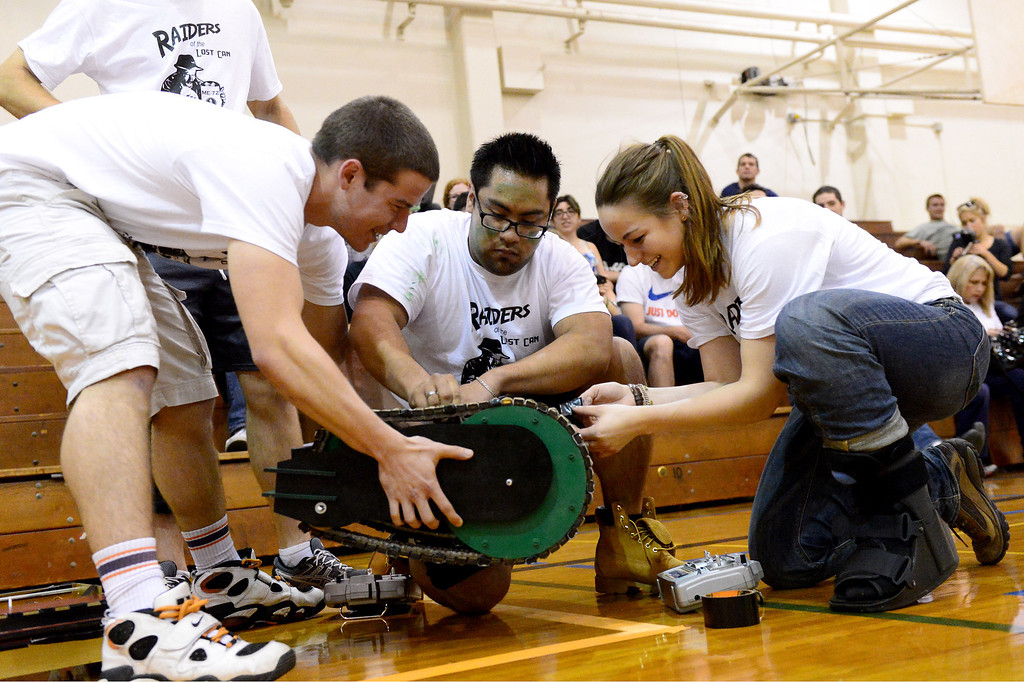 Description of . The Avengers, from left, Bryan Joel, Richie Hernandez and Erin Evans prepare a vehicle for a round as teams of mechanical engineering Caltech students compete in the annual ME72 Engineering Design Contest at the Pasadena campus Tuesday, March 11, 2014. The goal in