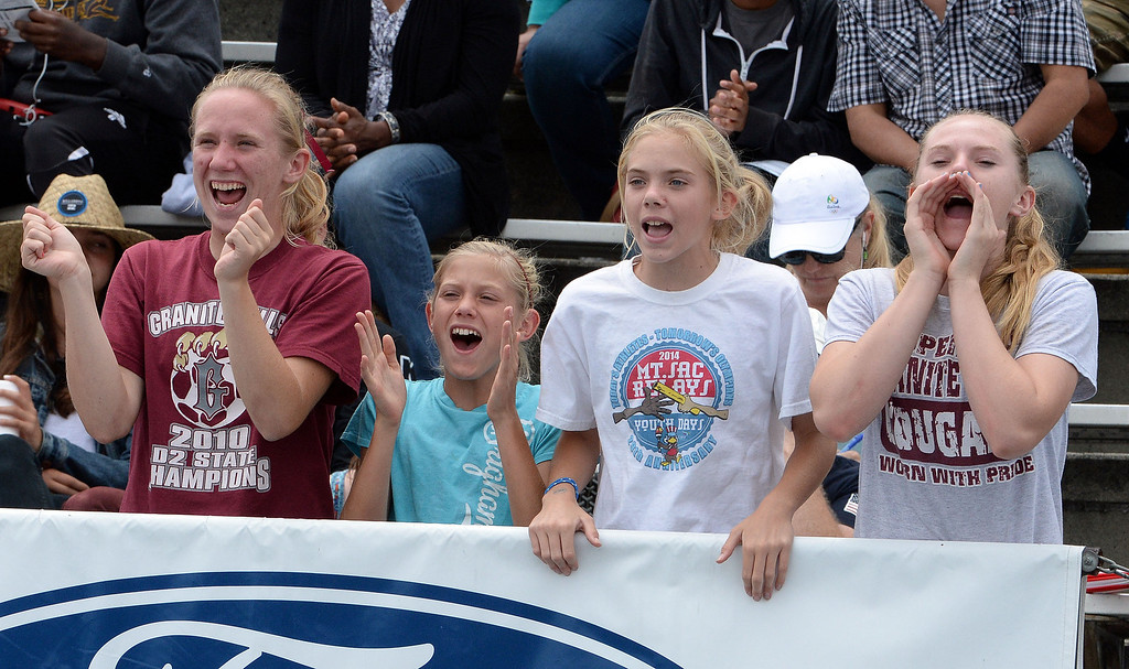 Description of . Fans cheer on athletes during the CIF Southern Section track and final Championships at Cerritos College in Norwalk, Calif., on Saturday, May 24, 2014. 