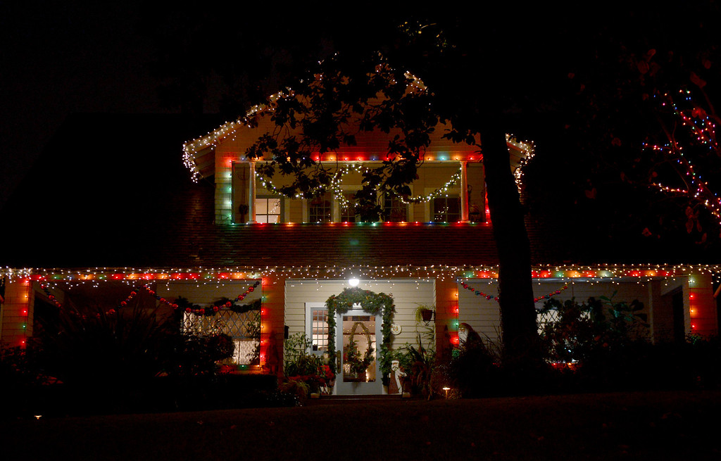 Description of . A house is lit up for the holidays on Orange Grove Boulevard Thursday night, December 19, 2013. (Photo by Sarah Reingewirtz/Pasadena Star-News)