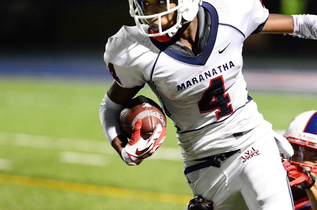 Description of . Maranatha plays La Salle in a prep football game Friday night, September 20, 2013 at La Salle High School in Pasadena. (Photo by Sarah Reingewirtz/Pasadena Star-News)