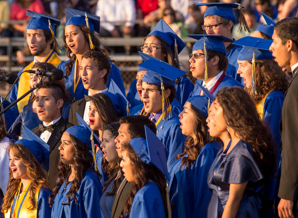 Description of . California High choir performs during graduation at their Whittier campus stadium June 13, 2013.   (SGVN staff photo by Leo Jarzomb)
