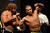 UFC fighters  Urijah Faber and Ivan Menjivar during weigh-ins for UFC 157 Rousey vs Carmouche at the Honda Center in Anaheim Friday, February  22, 2013.  (Hans Gutknecht/Staff Photographer)