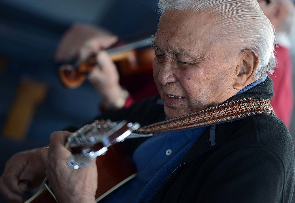 Description of . Conrad Adayan, 87, plays guitar with a group of fellow World War II Veterans. The Redlands Airport Philharmonic gather each Wednesday in the lobby of the Redlands Airport to share stories, coffee, donuts and