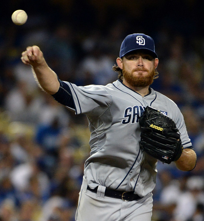 Description of . San Diego Padres starting pitcher Ian Kennedy throws to first base in the seventh inning of a Major league baseball game against the Los Angeles Dodgers on Saturday, July 12, 2014 in Los Angeles.   (Keith Birmingham/Pasadena Star-News)