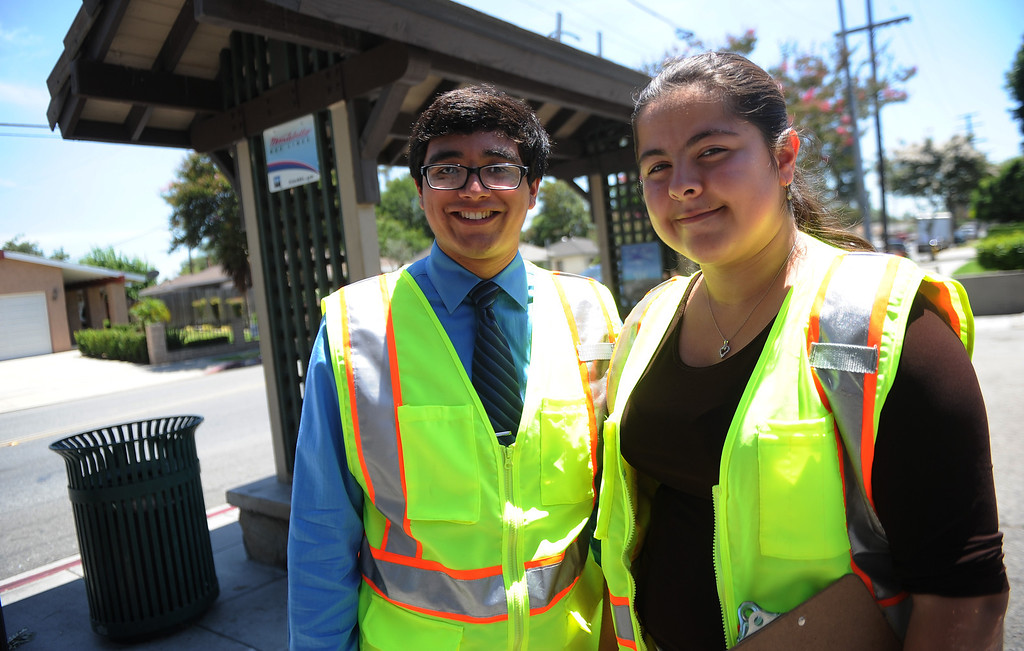 Description of . Interns Monserrat Marquez, right , a former El Rancho graduate along with Robert Sanchez a La Serna graduate after inspecting a bus stop at the corner of Passons Blvd and Jackson Street as part of the Pico Rivera college prep program on Tuesday, July 16, 2013 in Pico Rivera, Calif.   (Keith Birmingham/Pasadena Star-News)