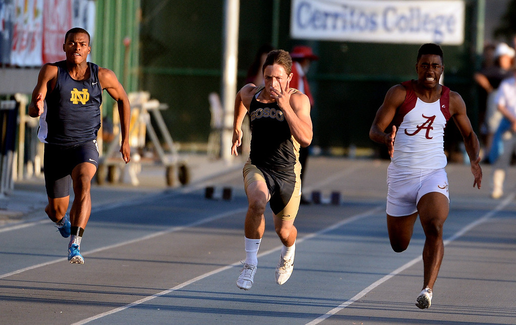 Description of . Notre Dame's Trevor Reid, left, St. John Bosco's Sean McGrew, center, and Alemany's Dominic Davis competes in the 100 meter dash during the CIF-SS Masters Track and Field meet at Falcon Field on the campus of Cerritos College in Norwalk, Calif., on Friday, May 30, 2014.   (Keith Birmingham/Pasadena Star-News)